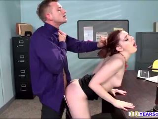 Hot redhead Ember Stone gets her ass cheeks spanked by a large dick