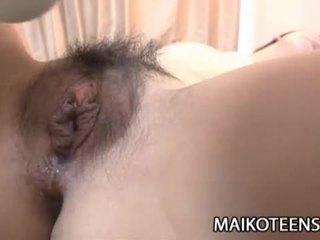 Naughty japanese teen yuma yoneyama opens hairy pussy for fucking