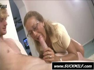 Mom in glasses gives blowjob on the sofa