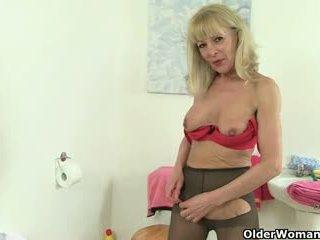 British granny Elaine fucks a dildo on...