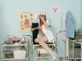 Horny blonde nurse in stockings plays with dildo in hospital
