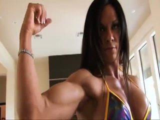 完美 健身 muscle 女人 flexing 她的 強 ripped biceps