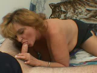 Mature woman blows a load