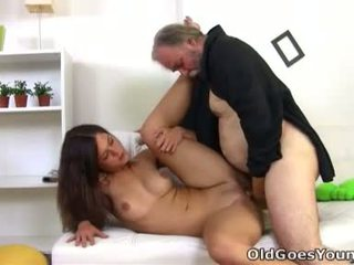 Alyona is a sexy young woman and she is sitting on the lap of her older sexy man