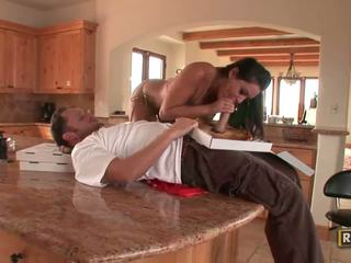 Housewife doing a blowjob to a pizza delivery boy in the kitchen