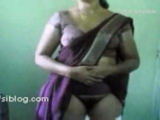 Lifting her saree