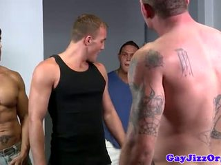 Alex Andrews gets two cocks in his mouth