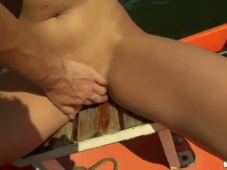 Suntanning Nikol fucked on boat for cash