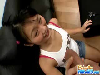 Horny tiny babysitter Evelyn shows off her ass and fingers deep